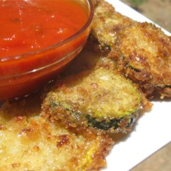 Easy Fried Zucchini Recipe - You don't need a lot of oil to fry these zucchini slices. Buttery cracker crumbs make a yummy, crunchy crust.