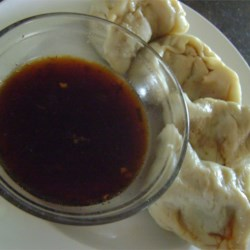 Oriental Sesame Dip Recipe - This soy sauce and sesame flavored dip is great for egg rolls, fresh or fried spring rolls, grilled meats or poultry.  Chill or heat before serving. This is also a great dressing for coleslaw -- just toss the slaw with the dressing and chill for up to 3 days. Add some shelled sunflower seeds and some crunchy chow mein noodles right before serving.