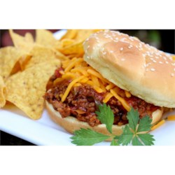 2-Step Beefy Taco Joes Recipe - Ground beef is cooked in the skillet and seasoned with a bold combination of Campbell's(R) Condensed Tomato Soup and Pace(R) Thick & Chunky Salsa, served on a sandwich bun and crowned with shredded Cheddar cheese.