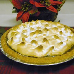 Sour Cream Raisin Pie IV Recipe -  Cream is soured with a bit of vinegar, and combined and cooked up with lots of yummy ingredients to make a thick, creamy custard. Plumped raisins and vanilla are stirred in, and then the filling is cooled, poured into a prepared pie crust, and topped with a lovely meringue. Bake until golden.