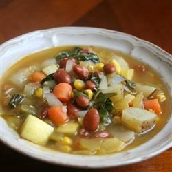 Vegetarian Green Chile Stew Recipe - A great way to use leftover veggies, this vegetarian stew is a delicious combination of carrots, celery, potatoes, squash, spinach, and green chiles.