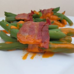 Green Bean Bundles I Recipe - Easy and impressive side dish made with green beans, bacon, and French dressing - great for a crowd. You'll need a few toothpicks to carry this recipe off right!