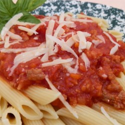 Tuscan Style Meat Sauce (Ragu Toscano) Recipe - This wonderful meat sauce of ground beef and pork is great served over spaghetti, fettuccini, or homemade ravioli.