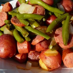 Amy's Po' Man Green Beans and Sausage Dish Recipe - Green beans, smoked sausage, and potatoes are cooked low and slow for a hearty dish that's easy on the wallet. An old-time recipe from Grandma's day.
