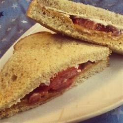 Simple Peanut Butter and Tomato Sandwich Recipe - An intriguing sandwich that combines the flavors of tomato, peanut butter, and mayonnaise is served on whole wheat bread.