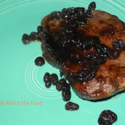 Raisin Whiskey Steak Recipe - Your favorite cut of steak is cooked in a sweet whiskey marinade. Plumped-up raisins add fruity flavor to every bite.