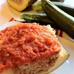 Mellas Family Lamb Stuffed Zucchini (Koosa) Recipe - Lamb, rice, and mint are stuffed inside large zucchini and braised in a cinnamon spiced tomato sauce.