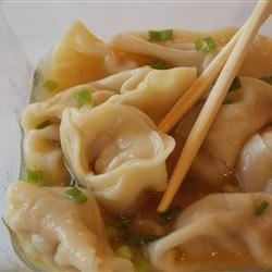 Chinese Egg Dumplings Recipe - Tender egg wrappers are filled with savory ground pork and Asian flavorings to make yellow dumplings that simmer in seasoned chicken broth.