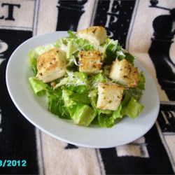 Almost Authentic Caesar Salad Recipe - Homemade croutons, romaine lettuce, and lemon juice-based dressing create this Tijuana-inspired Caesar salad in under an hour.