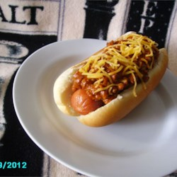 Hot Dog Chili for Chili Dogs Recipe - A tangy, spicy chili with ground beef and bacon is made just for slathering on a chili dog. It should be thick enough to stay where you put it.