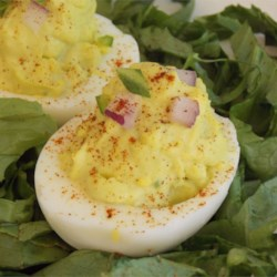 Deviled Eggs - Mexican Devils! Recipe - Avocado, jalapeno pepper, and a sprinkle of ground smoked chipotle pepper add texture and Mexican-inspired flavors to easy deviled eggs.