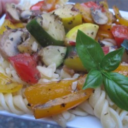 Summer Penne Pasta Recipe - Red, green and yellow bell peppers are lightly sauteed along with a succession of zucchini, yellow squash, mushrooms and garlic. Add chopped tomatoes and serve over freshly boiled pasta.