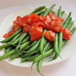 Green Beans with Cherry Tomatoes Recipe - These beans are briefly boiled and tossed with cherry tomatoes in a buttery basil sauce to make the most yummy green beans ever!