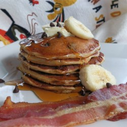 Elvis Pancakes Recipe - Pancakes flavored with peanut butter, banana, and chocolate chips make a breakfast fit for The King.