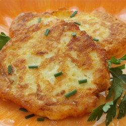 Old Fashioned Potato Cakes Recipe - These quick and easy potato cakes will have all the family members coming back for more. Just gather six simple ingredients for a tasty treat!