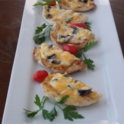 Aunt Kathy's Cheese Wedges Recipe - This is a yummy and cheesy appetizer. My Aunt Kathy gave me this easy recipe several years ago. These are so good!