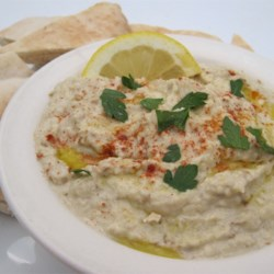 Baba Ghanoush Recipe and Video - This classic smoky, garlicky Middle Eastern roasted eggplant spread is easy to make at home.