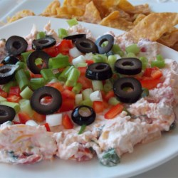 Quick Salsa Dip Recipe - A creamy salsa blend is topped with diced veggies. Serve this colorful dip with red and blue tortilla chips.