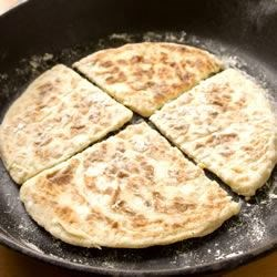 Irish Potato Farls Recipe - The word farl originates from the Gaelic word fardel meaning four parts. These potato griddle breads can be made with leftover mashed potatoes too.  Serve hot with a little butter and salt, or fry them alongside soda bread as part of an Ulster Fry-up.