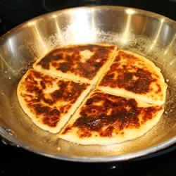 Fried Irish Potato Farls Recipe - Potato bread farls are pan fried to make one of the essential components of an Ulster fry. They taste great on their own with a little salt, or with a fried egg on top.