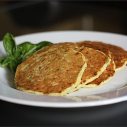Zucchini Cheddar Pancakes Recipe - Shredded zucchini and Cheddar cheese give these savory pancakes a splash of color and a hint of richness. Serve for brunch, lunch, or dinner!