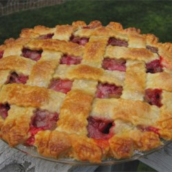 Rhubarb and Strawberry Pie Recipe - Sugar and flour are combined with strawberries and rhubarb, poured into a prepared crust, and topped with another crust. A delicious tart and sweet combination.