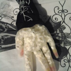 Halloween Popcorn Hands Recipe - Disembodied hands with candy corn fingernails are made of a popcorn-candy corn mix. Serve in their plastic gloves on a tray with a few plastic bugs scattered around for maximum creep factor. You can get the gloves at a crafts store.