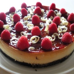 White Chocolate Raspberry Cheesecake Recipe - Raspberry sauce is swirled into the batter of a creamy white chocolate cheesecake. Garnish with white chocolate curls if desired.