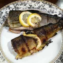 Whole Grilled Trout Recipe - Whole trout stuffed with herbs and flavorings, then grilled directly on grates, produces flavorful, flaky, tender fish with tasty crispy skin.