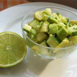 Tangy Cucumber and Avocado Salad Recipe - A great, fresh-tasting picnic salad, it combines avocados, cucumbers, garlic, and green onions with chopped cilantro and the bright flavors of lemon and lime juice.