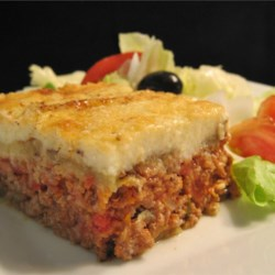 Moussaka Recipe and Video - Here is a great recipe for moussaka, a Greek dish. It includes sliced eggplant baked in a ground beef sauce and then smothered in a thin white sauce.