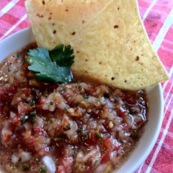 Simple Salsa Recipe - This low-cal salsa packs a punch with roasted habanero, jalapeno, and red chile peppers. Consider wearing latex gloves when handling the peppers during preparation!