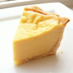 Anna's Custard Pie Recipe - Reminiscent of flan and baked in a short crust, this pie is a solution for those who dislike pumpkin yet crave a custardy end to their Thanksgiving feast.