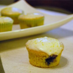 Pat's Blueberry Citrus Cake Recipe - A lemon cake mix is the starting point for a perfect summertime dessert. Frost the layer cake, full of blueberries and citrus flavors, with your favorite lemon frosting.