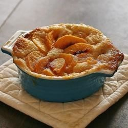 Kelley's Peach Cobbler Recipe - Fresh or frozen peaches can be used in this best-served-warm dessert. Top with whipped cream or vanilla ice cream for a truly decadent treat.