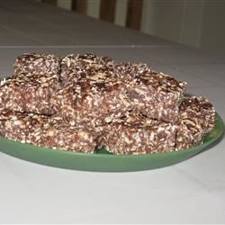 Bird Seed Squares Recipe - This is an easy, healthy, but yummy, no-bake snack that disappears quickly whenever I take it along. You can easily substitute other ingredients for the cereal part such as ground or chopped nuts, flax seeds, etc. If you don't have enough of one thing, just add more of another.
