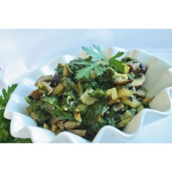 Savory Swiss Chard with Portobellos Recipe - Portobello mushrooms and leek stud this Swiss chard side dish covered with Parmesan cheese.