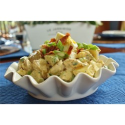 English Pub Potato Salad With Cucumber and Bacon Recipe - Serve a scoop of this hearty egg, cucumber, and bacon-filled potato salad alongside a burger or a sizzling steak.