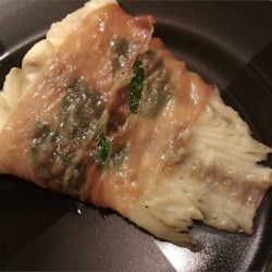 Basil and Prosciutto-Wrapped Halibut Recipe - Halibut fillets are wrapped in basil and prosciutto, pan-seared and finished in a hot oven for this fast and flavorful fish recipe.