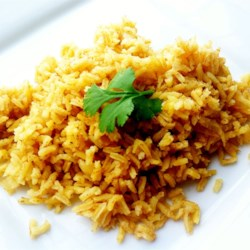 Indian Rice Pilaf Recipe - Indian-inspired rice is nicely spiced with curry powder, cinnamon, and garlic powder for a delicious and aromatic side dish.