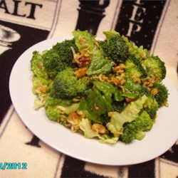 Crunchy Romaine Toss Recipe - Crunchy broccoli and romaine lettuce are tossed with an Asian-style sweet and sour dressing, then topped with ramen noodles for a refreshing salad good with any meal!