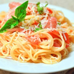 Summer Fresh Pasta with Tomatoes and Prosciutto Recipe - This quick, easy, and flavorful fresh pasta dish showcases summer's garden bounty using those wonderful home-grown tomatoes and fresh basil.