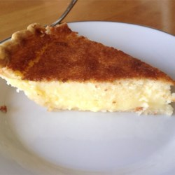 Buttermilk Pie with Molasses Recipe - Sweet, rich and creamy, this is a custard pie that no one will guess is made with buttermilk! It 's wonderful as is, but downright sinful when adorned with a spoonful of molasses.