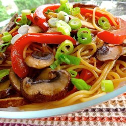 Asian Noodle Salad Recipe - A ginger, soy, and rice wine dressing is tossed into a bowl of just-cooked pasta, shiitake mushrooms, and red bell peppers for an easy, flavorful vegetarian meal. Makes two main dish servings or four smaller servings.