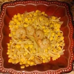 Linguine with Cajun-Spiced Shrimp and Corn Recipe - After throwing some ingredients together for tapas, the flavor was so fresh and light my family asked for more. By warming it through with a few more ingredients I turned it into a family meal with pasta instead of just a snack.