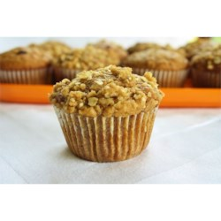 Pumpkin Muffins with Streusel Topping  Recipe - Moist and hearty pumpkin-oat muffins are topped with a brown sugar and oat streusel perfect for a quick breakfast or a holiday brunch.
