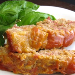 Turkey Cheeseburger Meatloaf Recipe - Ground turkey and turkey bacon add lightness to a meatloaf with the taste of a bacon cheeseburger.