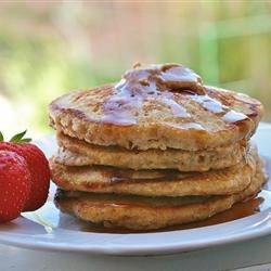 Quick Oatmeal Pancakes  Recipe - Include quick-cooking oats to your pancake batter for a hearty addition to the breakfast plate. Serve with your favorite sweet topping.