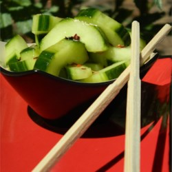 Spicy Asian Cucumbers Recipe - Cucumbers are tossed with Asian-inspired seasonings and marinated for a great side dish to serve cold.