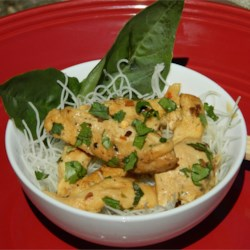 Thai-Style Chicken with Noodles Recipe - This is a great quick recipe for midsummer's nights. It has a creamy coconut blend, but beware of its sharp twist of chile pepper!